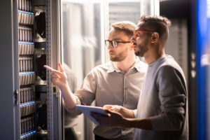 managed services provider talking to client next to servers